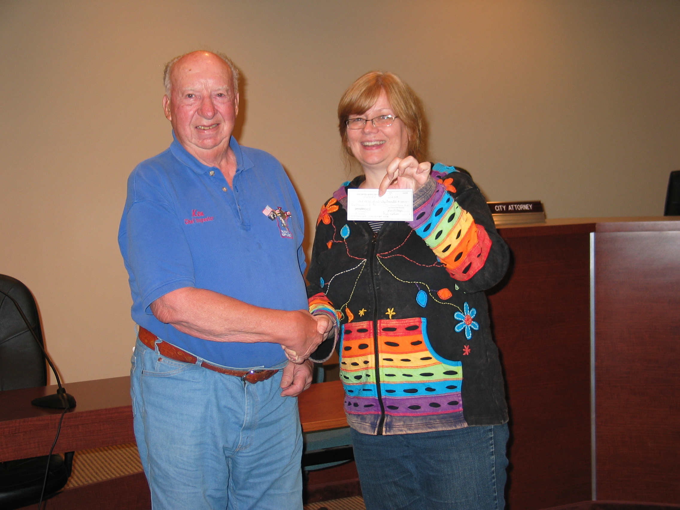 President Ken Langmade presenting donation check to Denise Lachinski for Booster Days.